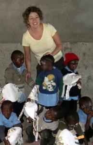Volunteer Jamie Piekarz with Peace Matunda children
